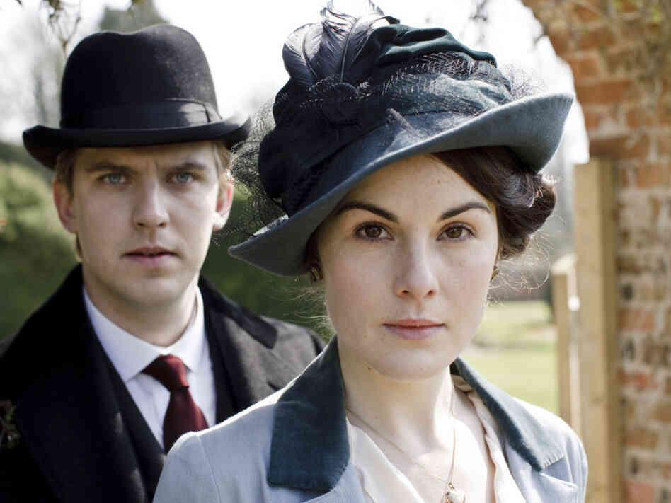 Downton Abbey depicts the lives of the noble Crawley family, including Mary and Matthew Crawley, played by Michelle Dockery and Dan Stevens.