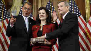 House Speaker John Boehner of Ohio participates in a ceremonial swearing in with Rep. David Schweikert (R-AZ) on Capitol Hill in Washington on Wednesday.