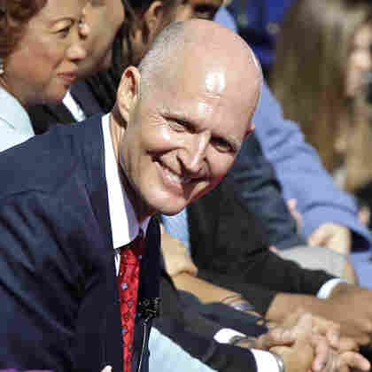 Florida Gov. Rick Scott smiles during inauguration ceremonies in Tallahassee Tuesday. Scott defeated incumbent Charlie Crist, who had been elected as a Republican.