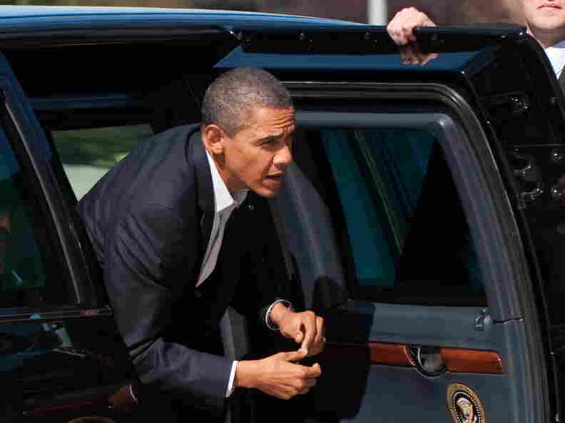 President Obama gets out of his limousine.