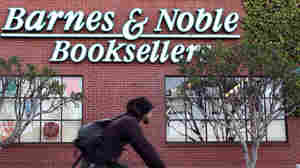 A bicyclist rides by a Barnes and Noble Bookstore on December 7, 2010 in San Francisco, California.