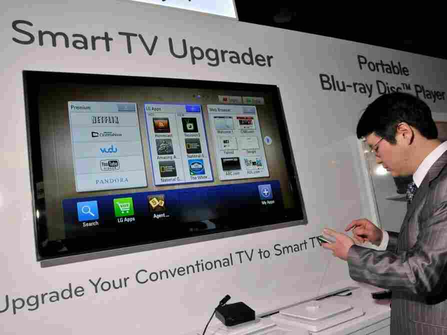 LG shows off a set-top box at the Consumer Electronics Show that willwill upgrade a conventional televison to a smartTV.
