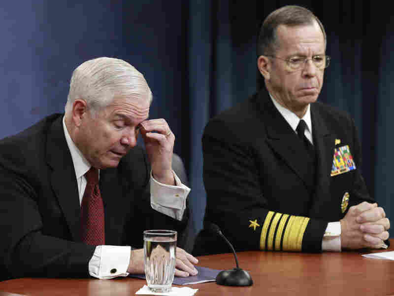 Defense Secretary Robert Gates (left) and Joint Chiefs Chairman Adm. Mike Mullen discuss defense budget cuts during a news conference at the Pentagon on Thursday.