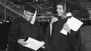 Hamilton Holmes and Charlayne Hunter of Atlanta examine diplomas awarded during the University of Georgia's 160th commencement in Athens, Georgia, June 3, 1963. They are the first blacks to attend the nation's oldest land grant college.