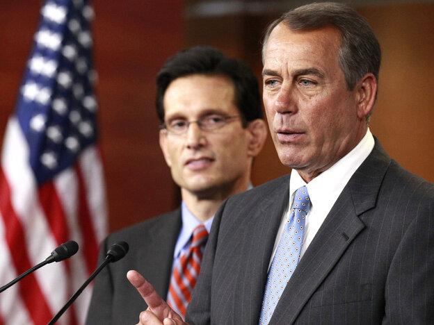 Speaker John Boehner makes a point while Majority Leader Eric Cantor listens.