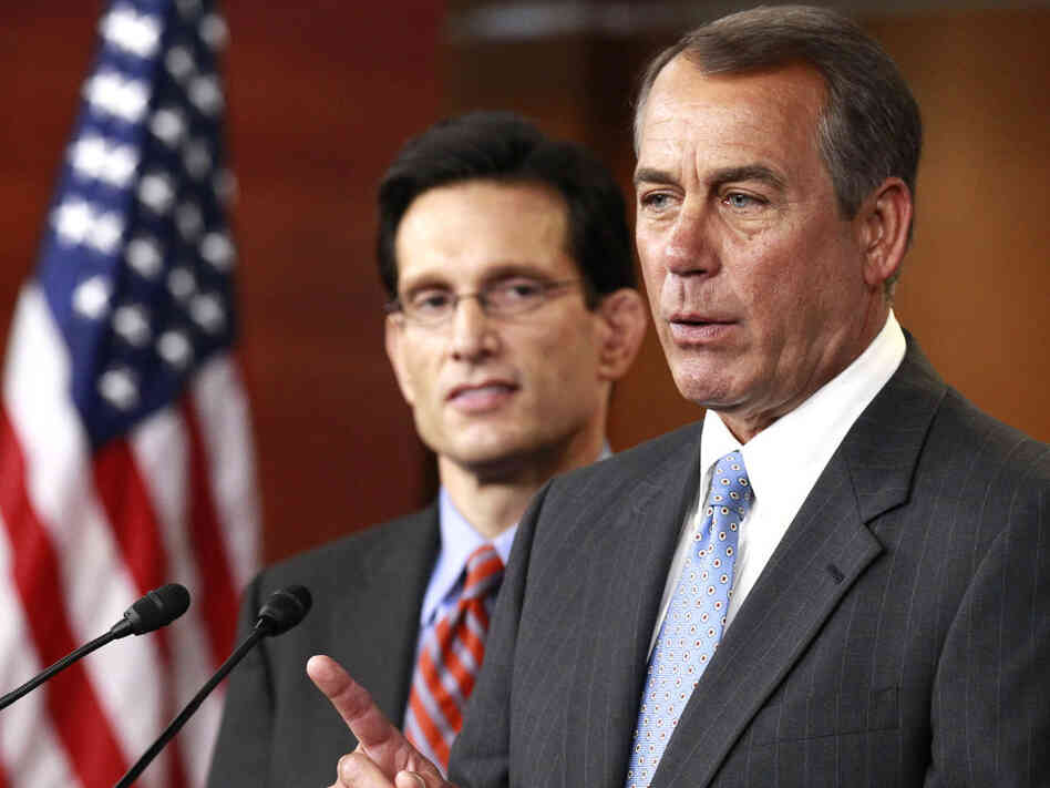 Speaker John Boehner makes a point while Majority Leader Eric Cantor listens.
