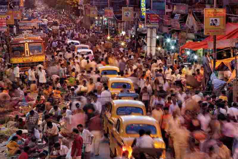 """Its steaming streets crammed with vendors, pedestrians and iconic ambassador taxis, Calcutta throbs with some 16 million people — and more pour in every day from small towns. In 1975 only three cities worldwide topped ten million. Today 21 """"megacities"""" exist, most in developing countries."""