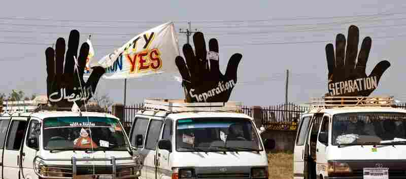 Sudanese supporters of secession display signs on their vehicles.