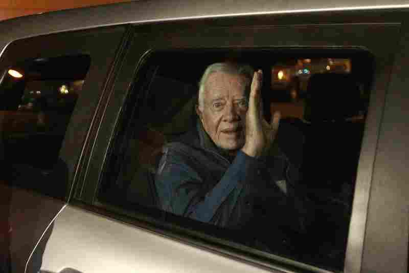 Former U.S. president Jimmy Carter arrives in Khartoum on Thursday. The international community is watching Sudan closely, as many fear the vote could spark nationwide violence.