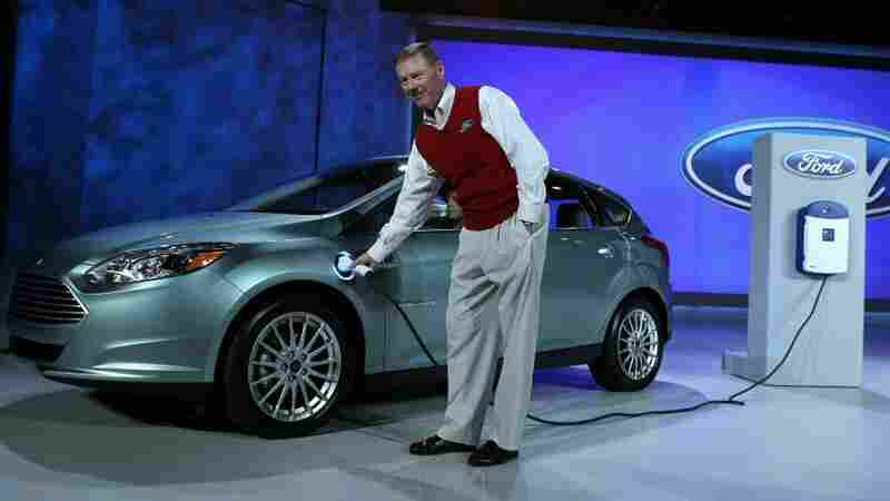 Ford President and CEO Alan Mulally plugs in the new all-electric Ford Focus at the Consumer Electronics Show.