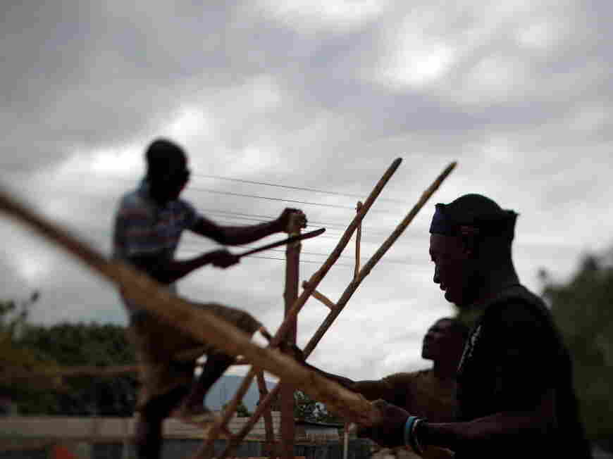 Men build the frames for improvised classrooms to replace a  Port au Prince school that collapsed after the Haitian earthquake.
