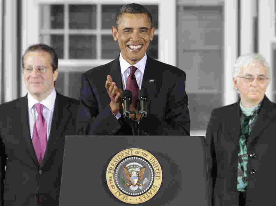 President Obama with Gene Sperling (l) his new director of the National Economic Council and Katharine G. Abraham, a new member of his Council of Economic Advisers.