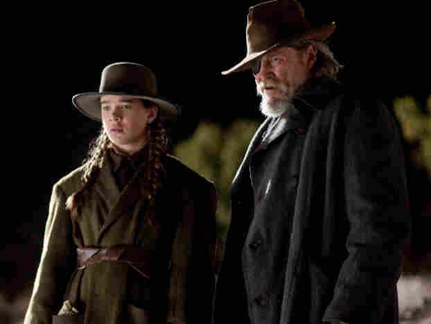 "Mattie Ross (Hailee Steinfeld) and U.S. Marshal Reuben ""Rooster"" Cogburn (Jeff Bridges) seek the man who gunned down her father in Joel and Ethan Coen's True Grit"