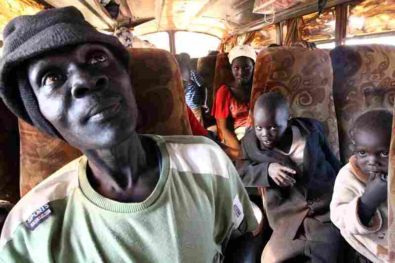 Southern Sudanese wait aboard a bus in the al-Andalus area outside the northern capital of Khartoum on Thursday. Some 55,000 Sudanese have returned south ahead of the election, according to the U.N. refugee agency.
