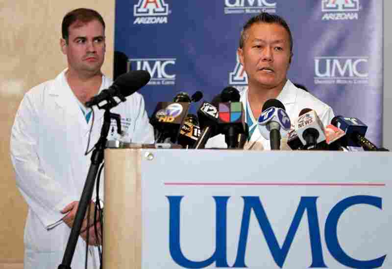 At a Sunday news conference in Tucson, Dr. Peter Rhee (right) and Dr. G. Michael Lemole Jr. said Giffords is able to follow verbal commands.