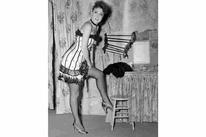 """Actress, burlesque queen, author, playwright — Gypsy Rose Lee ranged all over the entertainment landscape. Here she prepares for her role as a Floradora girl in the 1939 Broadway comedy """"I Must Love Someone,"""" in 1939."""