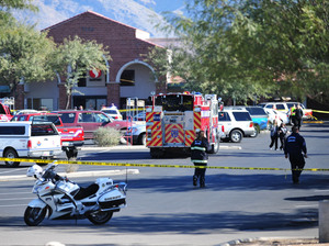 Emergency responders surround the scene of a shooting where a gunman opened fire Saturday, shooting Rep. Gabrielle Giffords and several others in Tuscon, Ariz.