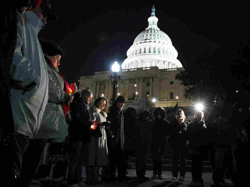 People gather for a candlelight vigil for the victims of a shooting rampage in Arizona, at the steps of the Capitol in Washington on Saturday.