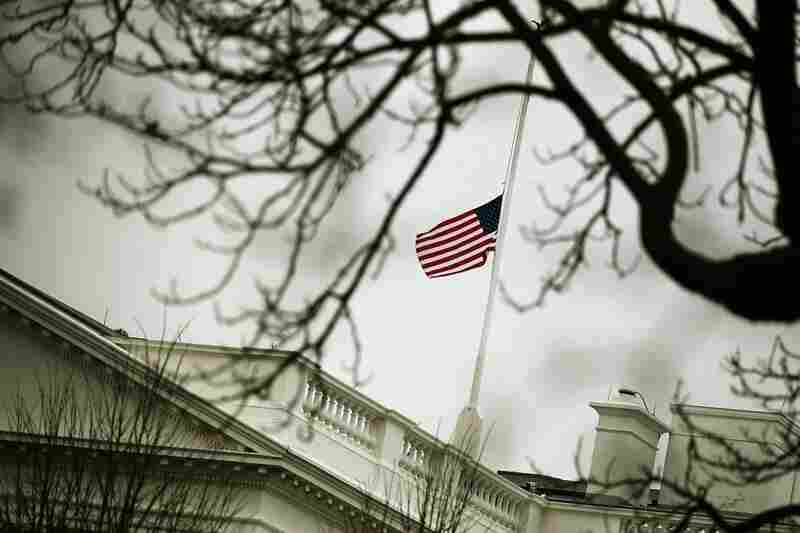 The flag on op top of the White House flies at half-staff Monday in honor of those killed and wounded in Tucson.