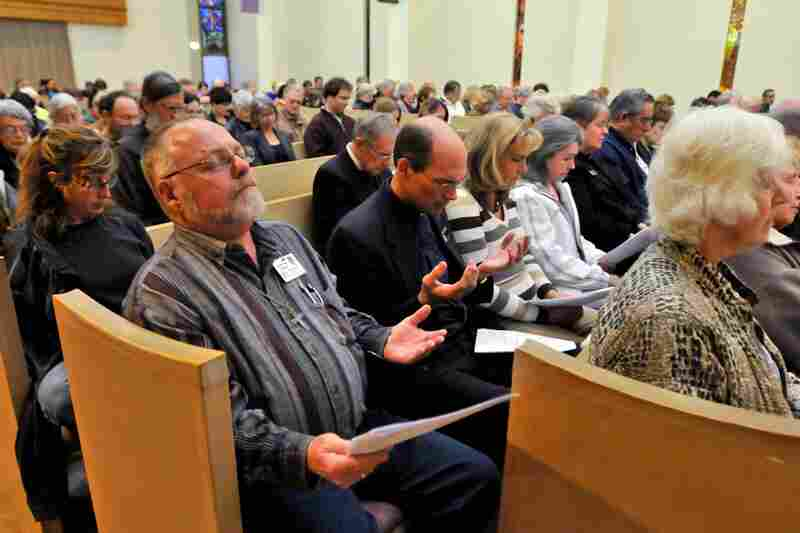 Parishioners attend an interfaith service at the Catalina United Methodist Church on Tuesday in Tucson.