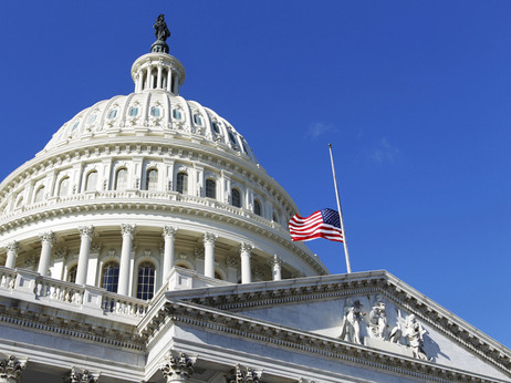 The American flag flies at half-mast on the U.S. Capitol in Washington Sunday, Jan. 9, 2011.