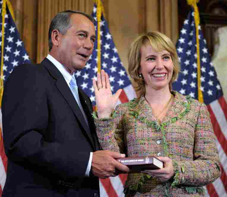 "Giffords, a moderate ""Blue Dog"" Democrat, was re-elected in November after a close runoff with Tea Party-backed Republican Jesse Kelly. House Speaker John Boehner (R-OH) re-enacts Giffords' swearing-in on Jan. 3 in Washington, D.C."