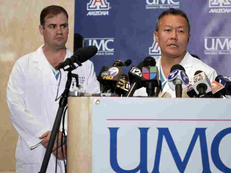 Dr. Peter Rhee (right) discusses Rep. Gabrielle Giffords' condition. The three-term Arizona Democrat was shot in the head Saturday.