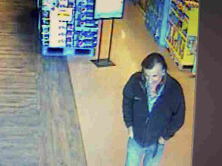 """A security camera image shows a """"person of interest"""" the Pima County Arizona Sheriff's Department hopes to identify in connection with the shooting of Rep. Gabrielle Giffords, and nearly 20 others, Saturday Jan. 8, 2011,"""