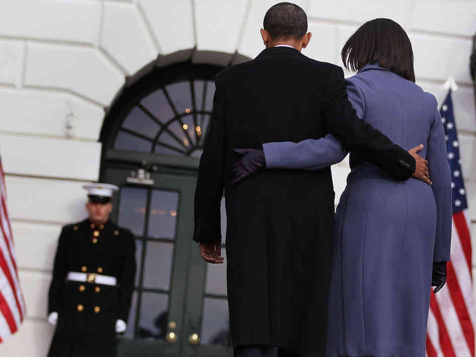 President Obama and first lady Michelle Obama depart Monday after observing a moment of silence to honor those killed and wounded during Saturday's shooting in Tucson, Ariz.
