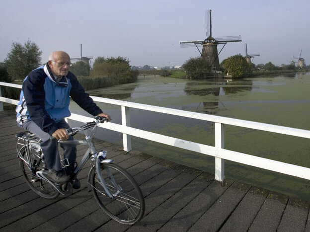 Dutch researchers have found that those with atypical parkinsonism were less likely to be able to ride a bike compared with patients with Parkinson's disease. A Dutch man who was not in the study rides his bike in front of windmills in Kinderdijk, the Netherlands in 2007.