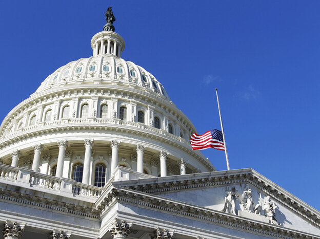 The American flag flies at half-staff on the U.S. Capitol in Washington Sunday, Jan. 9, 2011, to honor Gabe Zimmerman.