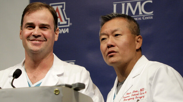 Dr. G. Michael Lemole, Jr., left, looks on as Dr. Peter Rhee talks about the condition of U.S. Rep. Gabrielle Giffords (D-AZ), at University Medical Center during a news conference in Tucson, Ariz., Monday, Jan. 10, 2011.