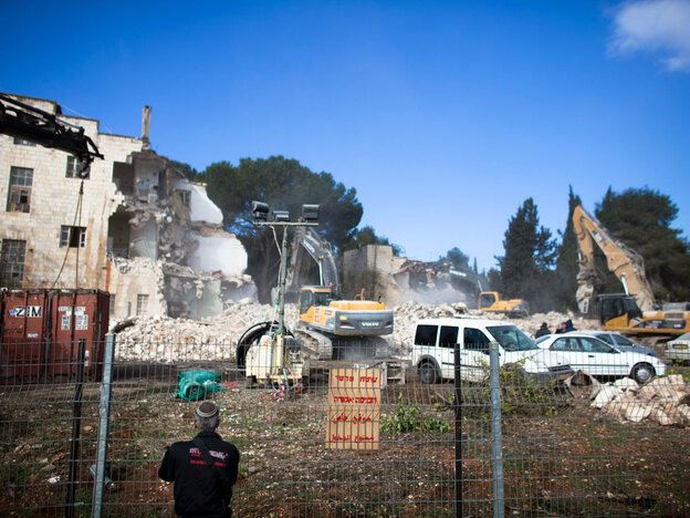 Israeli bulldozers demolish the Shepherd Hotel in the East Jerusalem neighborhood of Sheikh Jarrah on Sunday.