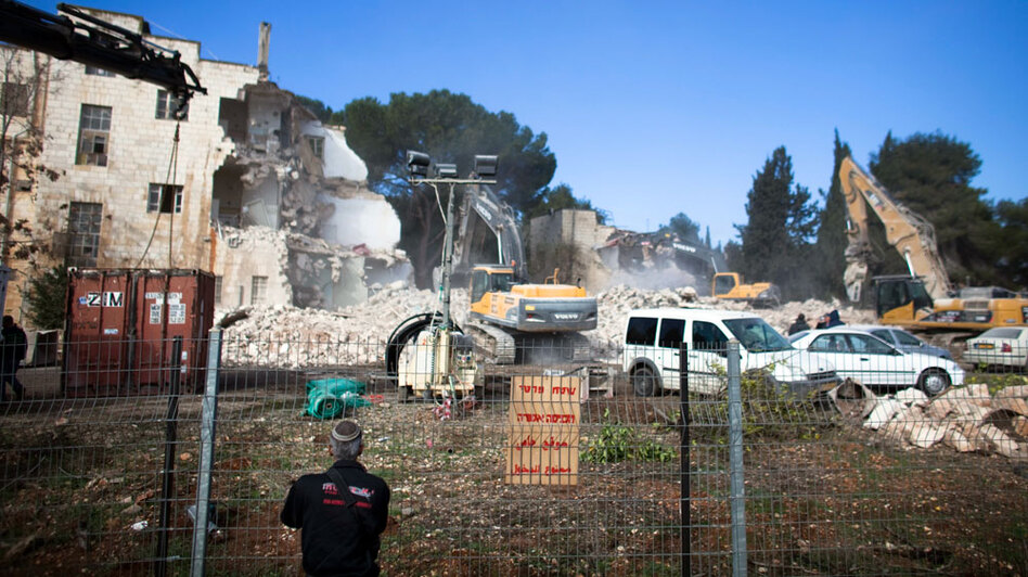 Israeli bulldozers demolish the Shepherd Hotel in the East Jerusalem neighborhood of Sheikh Jarrah on Sunday.