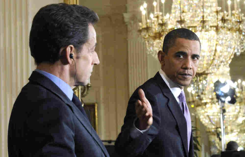 French President Nicolas Sarkozy listens as President Barack Obama speaks at the White House last March.