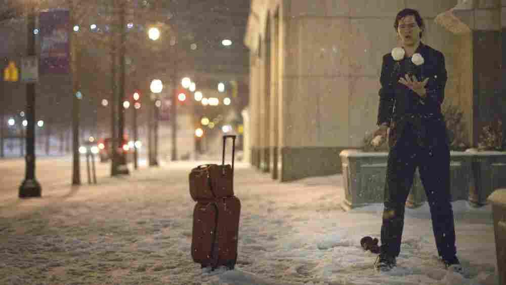 Adrian Hagen of Florida stops to juggle snow balls while walking along Peachtree Street in Atlanta.