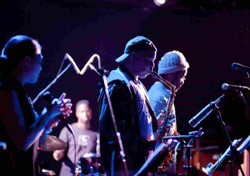 Steve Coleman wore his standard t-shirt and backwards ball cap ensemble to his gig with his band Five Elements. Shown here are Jen Shyu on vocals, Marcus Gilmore at drums and Jonathan Finlayson on trumpet.