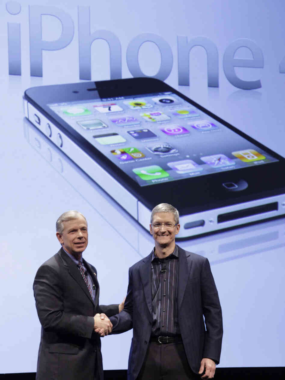 Lowell McAdam (left), Verizon's president, and Tim Cook, chief operating officer of Apple, announce that Verizon Wireless will carry Apple's iPhone 4. Verizon's iPhone has a new feature -- a mobile hot spot.