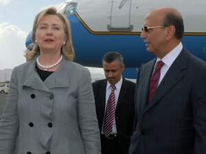 Secretary of State Hillary Clinton is welcomed by Yemen's foreign minister, Abu Bakr al-Qurbi, at Sanaa airport upon her arrival earlier today (Jan. 11, 2011).