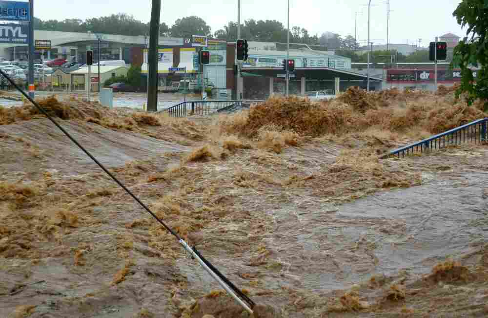 Water gushes into a shopping center in Toowoomba, Australia as the region braces for more deadly flooding.
