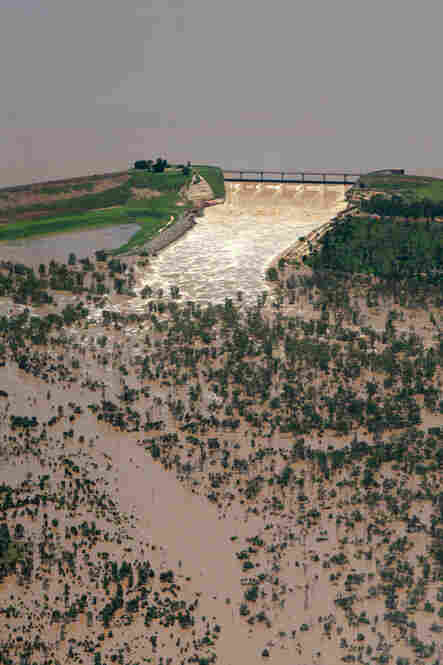 This aerial photo taken Dec. 31 shows the Fairbairn Dam spilling into the Queensland town of Emerald. Floodwaters have torn a deadly path through Australia's northeast in what may be the area's worst flooding in more than three decades.