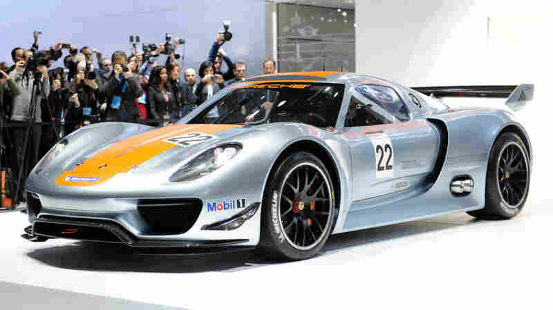 Porsche unveils its 918 hybrid sports car during the North American International Auto Show.