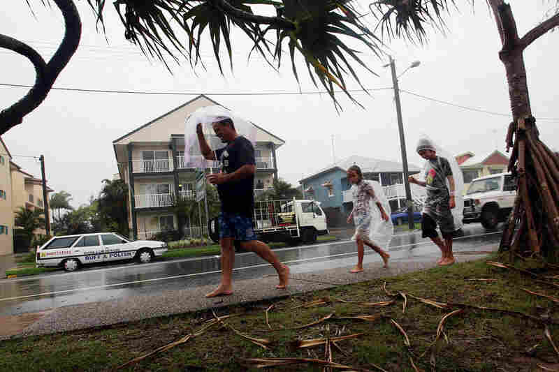 Residents walk in torrential rain in the town of Maroochydore.
