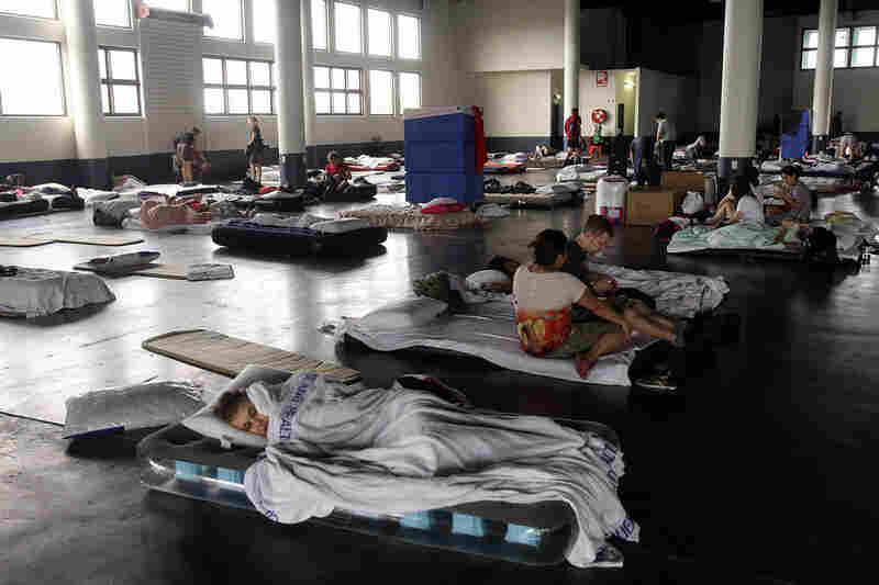 Residents take shelter at the RNA Showgrounds in Brisbane on Jan. 12. Several towns and suburbs in and around Brisbane were evacuated.