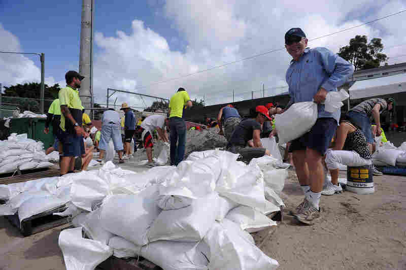 Volunteers fill sand bags at Brisbane City Council.