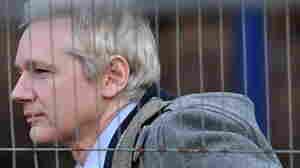 WikiLeaks founder Julian Assange arrives at Belmarsh Magistrates' Court in south-east London.