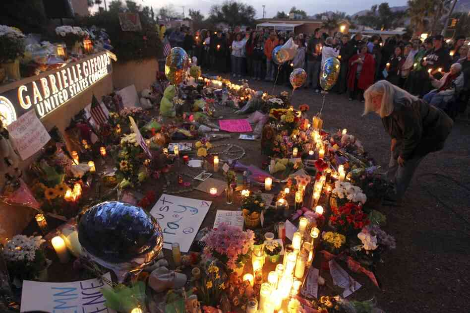 Supporters of U.S. Rep. Gabrielle Giffords (D-AZ) gather for a vigil outside her offices in Tucscon, Ariz. Giffords and 18 others were shot on Saturday outside a local supermarket; six were killed.