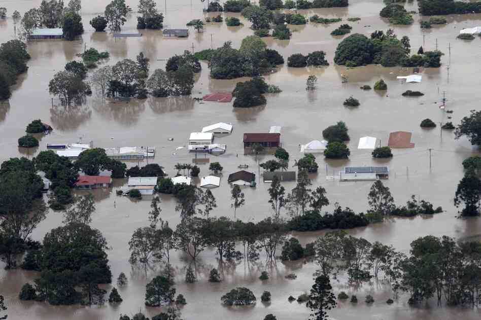 Floods triggered by tropical cyclone Tasha have ravaged an area in Australia the size of France and Germany combined. An entire suburb outside Ipswich, west of Brisbane, is submerged on Jan. 12.