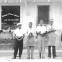 Frank Morris (in the apron and visor) is seen standing in front of his shoe shop in the 1950s. He was killed when his shoe shop burned down in Ferriday, La., in 1964.