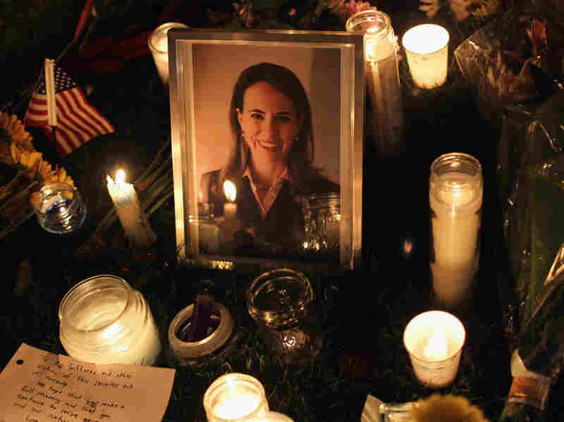 People place candles around a portrait of U.S. Rep. Gabrielle Giffords, who was shot Jan. 8 in Tucson, Ariz. Giffords was shot in the head at a public event, allegedly by Jared Loughner.